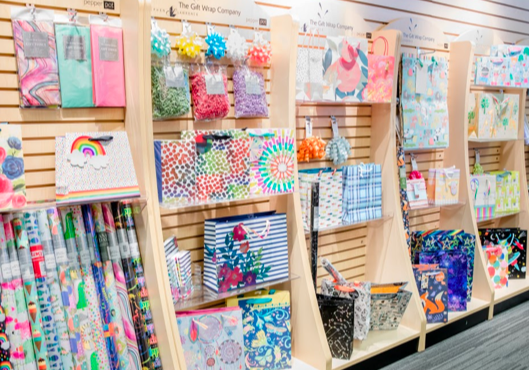 A selection of gift products including wrap and bags