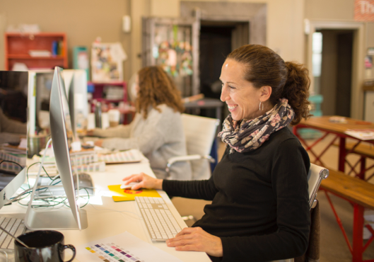 Design Group Americas designer works in a studio